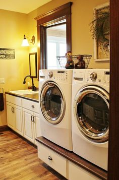The Washer and Dryer are easily accessible by sitting on a pedestal - and there is extra storage below!