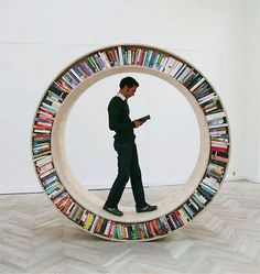 another circular bookcase, but this time you can feel like a guinea pig