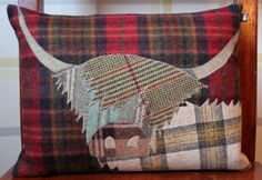 £68.65 Beautiful handmade Highland Cow cushion, filled with a feather pad. http://www.onemoregift.co.uk/