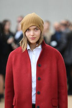 beanie weather. Red coat. White shirt. Camel and red.