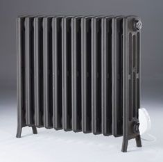 Electric Etonian - traditional style cast iron radiator in an electric versions. Electric Radiators, Cast Iron Radiators, Column Radiators, Doors And Floors, Cool Office Space, Designer Radiator, Towel Rail, Central Heating, Heating And Cooling
