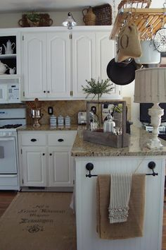 remove kitchen cabinet doors over microwave & paint the interior black for display + stenciled sisal rug~