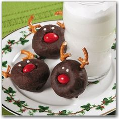 reindeer donuts....choco donuts, pretzel antlers, m for the nose