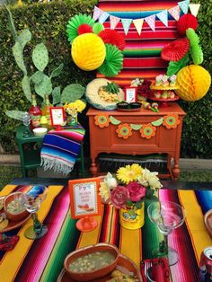 My backdrop consisted of a Mexican serapi. I then added big yellow tissue balls, and tissue fans in green & red. I clustered them together, and hung them on both sides. With all the fun printables from Sweet Pop Studio, I made banners