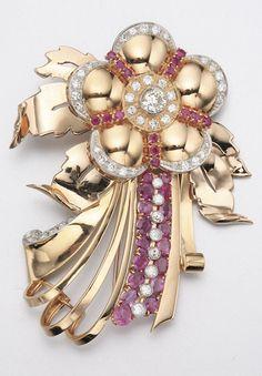 18K GOLD, DIAMOND AND RUBY BROOCH, CIRCA 1945 50 diamonds approx 3.50 cts.