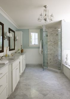 Liz Levin Interiors - Bathroom with 12' x 12' white Carrara Marble floors and Benjamin Moore Palladian Blue wall paint
