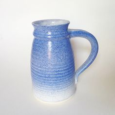 A personal favorite from my Etsy shop https://www.etsy.com/listing/400646259/studio-pottery-pitcher-o-handled-vase-in
