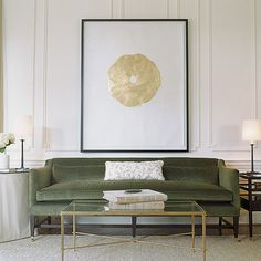 Lovely green velvet sofa with gold coffee table. Love the gold art on the wall
