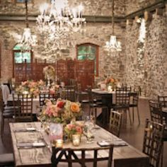 Crystal chandeliers juxtapose against 100+ yr old stone walls at Brotherhood Winery. Farmhouse tables, candles, coral flowers. Event coordination & decorating by Ali Barone Events www.nyweddingmaven.com
