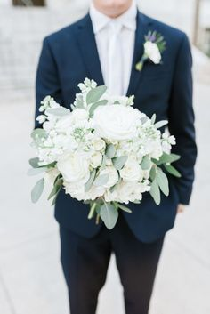 I also like the more simple greenery and white/cream for the bouquet. Love the groom's boutonniere here with the lavender accent haare hochzeit wreath wedding flowers flowers summer flowers white wedding White Wedding Bouquets, Floral Wedding, Bridal Bouquets, Diy Bouquet, Wedding Greenery, Bridal Flowers, Rose Bouquet, Trendy Wedding, Summer Wedding