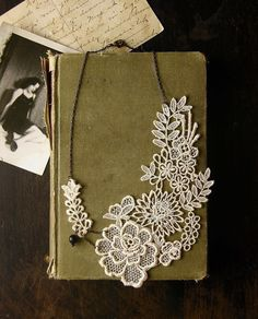 the sweetness of an extravagant lacy garden contrasts with antiqued chain and a solitary ebony vintage bead.