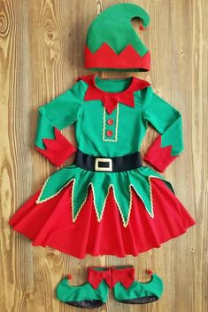 This costume made with high quality cotton and flexible combing cotton / futter fabrics. Red parts on T-shirt are made with fleece fabrics. Hat is made with felt fabric. Elf shoes base are used with anti-slip fabric. Shoes are optional. Christmas Dress Up, Christmas Elf Costume, Christmas Scenes, Diy Halloween, Kids Elf Costume, Diy Costumes, Pirate Costumes, Halloween Costumes, Robin Costume