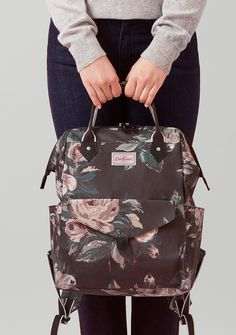 A dark floral to carry delicate roses into the winter season.