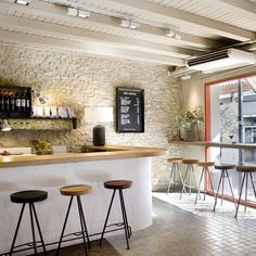 The pre-existing building features have been retained, the stone walls, brick, wooden beams across vaulted ceilings ensure the interior doesn't feel as aesthetically sterile as we're sure the chopping boards are kept...
