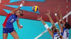Nataliya Goncharova of Russia spikes the ball