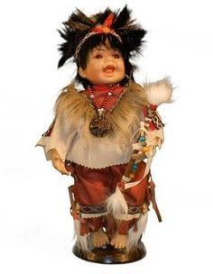 Native American Doll Wearing Feathered Head Gear
