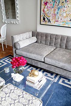 Grey velvet sofa + blue rug - living