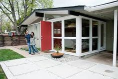 Red door entrance to 1950's ranch style California home.