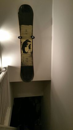 Wall mount snowboard