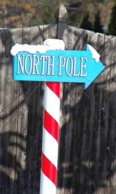 Diy Christmas North Pole. Use PVC and red duck tape. Glue sign to PVC and top with cotton balls or white craft fur. #CKCrackingChristmas