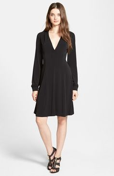 Free shipping and returns on MICHAEL Michael Kors V-Neck Fit & Flare Dress at Nordstrom.com. Princess seaming shapes the flattering fluid style of a matte jersey dress with an alluring décolleté neckline. Sleek faux-leather trim at the shoulders and back collar caps off the sophisticated design.