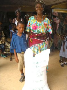 A happy family receives rice from the Family Support Program