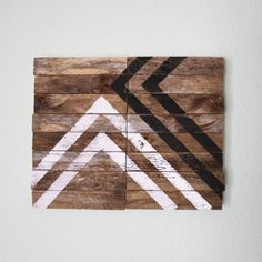 paint geometric shapes on reclaimed wood to make a rustic modern wall hanging