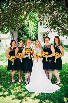 black dress bridesmaids with sunflower bouquets @weddingchicks