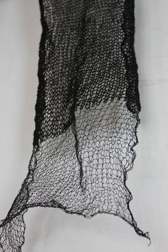 Black knitted scarf of silk-wrapped stainless steel and wool (Habu Textiles), by HighDesertHandwovens on Etsy