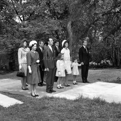Queen Elizabeth and Prince Philip are joined by Jacqueline Kennedy and her children, along with John F. Kennedy's siblings Patricia Lawford, Bobby and Ted Kennedy at the 1965 dedication of the lovely JFK memorial at historic Runnymede. Note the touching way that Prince Philip is holding young John Jr.'s hand.