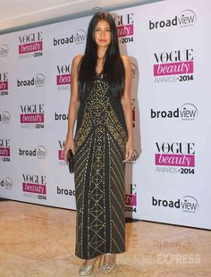 Model Carol Gracias picked a gold studded black gown with metallic sandals at Vogue Beauty Awards 2014. #Style #Page3 #Fashion #Beauty