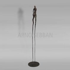 aRno SEBBAN - attirée par la lumiere. I worked the metal so that the light would play across the face, over the female hips, as well as to give the impression that the figure is rising upwards as if drawn by the light.