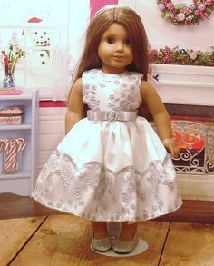 Beautiful metallic silver embroidered party dress, headband, and shoes for you American girl doll, or similar 18 inch dolls. This dress is made from a white bridal satin, with a metallic silver embroidered mesh bodice, and hemline. The dress closes in the back with velcro, and has a silver satin ribbon bow, with rhinestone buckle at the waistline. The listing also includes a silver headband with silver sequin trim, and silver sparkle ballet flats. Doll is not included,   All my apparel is…