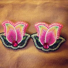 My new earrings that I will be wearing with my jingle dress. #nativechick #nativebling #nativewoman #jewelry #beadwork #suede #nativepride #jingledress #tulips ❤️☺️