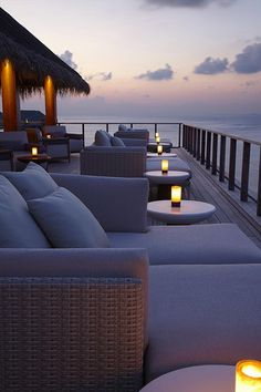 Beach House Outdoor Living on the deck over looking an amazing view of the ocean.Love the candles at sunset.