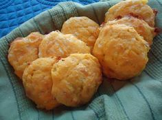 Coconut Flour Cheddar Drop Biscuits ¼ c coconut oil or butter, melted 1/3 c sifted coconut flour 4 eggs ¼ tsp salt ¼ tsp onion powder ¼ tsp baking powder ½ c sharp cheddar cheese, shredded Blend eggs, coconut oil or butter, salt, and onion powder. Combine coconut flour with baking powder and whisk into batter until there are no lumps. Fold in cheese. Drop by the spoonful onto a greased cookie sheet. Bake at 400 degrees for 15 minutes. For a cheesier biscuit increase cheese to ¾ cup.