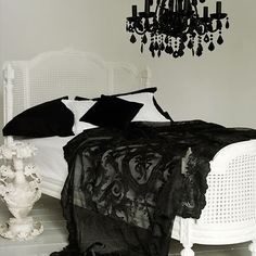 White bed and black lace