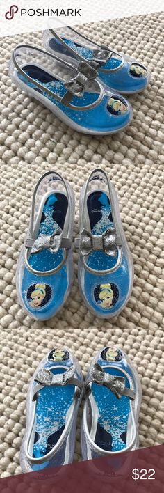 Disney Princess Cinderella Clear Glass Slippers 8 Disney Princess Cinderella Clear Ballet Girls Toddler Shoes Size8. EUC. Barely worn.   Give her majestic style with these Disney CINDERELLA dress-up Mary Jane shoes.  Cinderella image printed on footbed Heart with Cinderella detail Glitter accents Elastic strap gives a snug fit. Manmade upper, lining & outsole Round toe Elastic closure Padded footbed 1-in. heel Disney Shoes