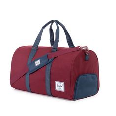 Herschel Supply Co. Duffle in Burgundy and blue.