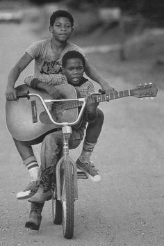 Just started playing guitar and I love my bike. So, this picture def hits home. Love it.