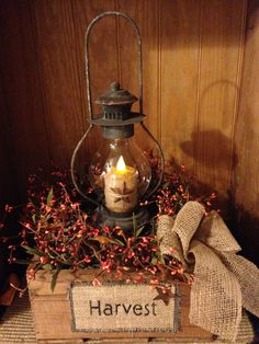 This gorgeous fall arrangement features a reclaimed wooden box with sunset orange pipberries and rusty tin stars. In the center of this arrangement is a 16 rustic lantern with a timer candle. Fall Lanterns, Rustic Lanterns, Christmas Lanterns, Lanterns Decor, Christmas Centerpieces, Rustic Christmas, Christmas Decorations, Vintage Christmas, Candle Lanterns
