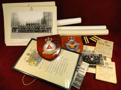 133) Box of military related items – photographs, plaques, posters etc Est. £20-£30