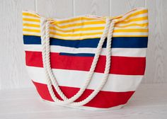 Large tote bag, beach bag. Carry all bag. Nautical stripes in yellow, blue and red via Etsy.