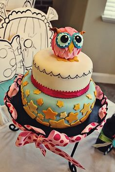 @Erin B B B Crandall Think you could make a smaller version of this owl for Kinslee's sheet cake also like the stars and of course she needs a fairy? Color scheme is green pink and red  I'm going to make the toadstool cupcakes and star wand cookies myself I have pinned on this board.