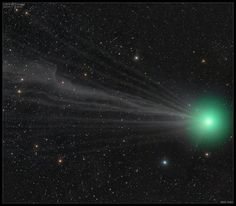 High resolution 3 panel mosaic of Comet Lovejoy on January 11, 2015. Field of view is approximately 3.5° x 2° and composed of three fields. Many fine streamers are visible emanating from the nucleus. (Credit & copyright: SEN/ Damian Peach)