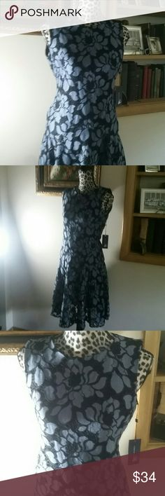 Tommy Hilfiger Blue and Black Floral Lace Dress 8 Feminine and lovely Tommy Hilfiger black and blue lace dress. The skirt has a lovely flounce and the dress  is fully lined. Dress is a size 8, new with tags intact. Tommy Hilfiger Dresses