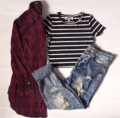 black and white stripped cropped tshirt with thick black stripes and thin white stripes, dark red plaid button up collared shirt, loose boyfriend jeans tattered and torn and cuffed at the bottom.