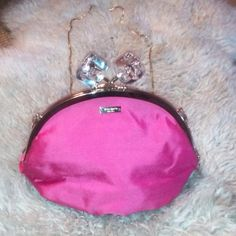 Kate spade cross body RARE Super chic Kate spade clutch/cross body. Practically new. Used a few times. Only flaw is seen in second pic, a free tiny black marks on the inside. This bag retails for $250 on eBay. Hot pink, with gold chain. Chain can be removed if desired. kate spade Bags