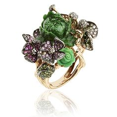 A Rose of 15.18ct vibrant carved Jade is the center piece of this incredible ring. Surrounded by Green Garnet, Green Turqoise, and Pink and White Sapphire leaves. Attention to detail and sculptured settings are Wendy's trademark. Each handcrafted piece is a miniature work of art, with every stone meticulously hand selected for its colour and cut, individually worked into her unique designs. Wendy Yue