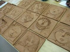 Clay relief self-portraits